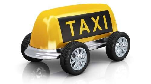 Creative taxi concept: car from yellow taxi roof sign and wheels isolated on white background with reflection effect